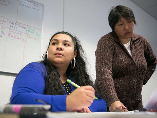 Celic Miranda (left) works on her math as part of the GED program at Claymont Learning Center.