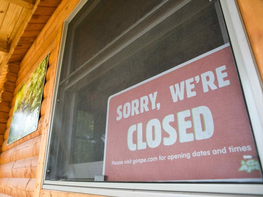 A closed sign on the window of Go Ape at Lums Pond which remains closed after the death of a Felton woman when she fell to her death last week.