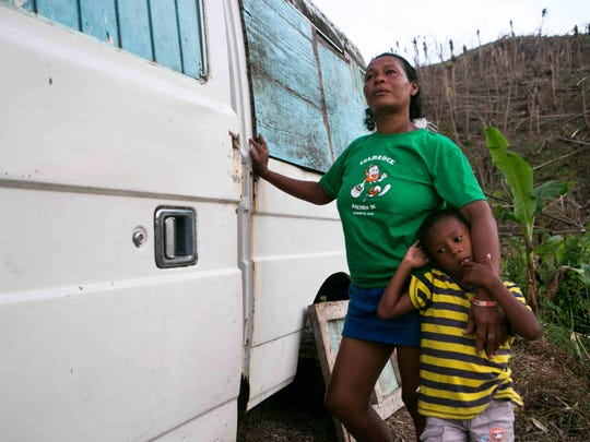 Rosillia Froncrs and her 4-year-old son are left without a home which was destroyed by Hurricane Maria. She was living with her uncle but her sister recently gave her a non-working van sitting on the hillside of Salybia as her new home to live in.