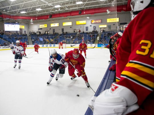 In a footrace Tuesday are Joel Farabee (28) and Jacob Hetz (28), of the U18s and Ferris State, respectively.