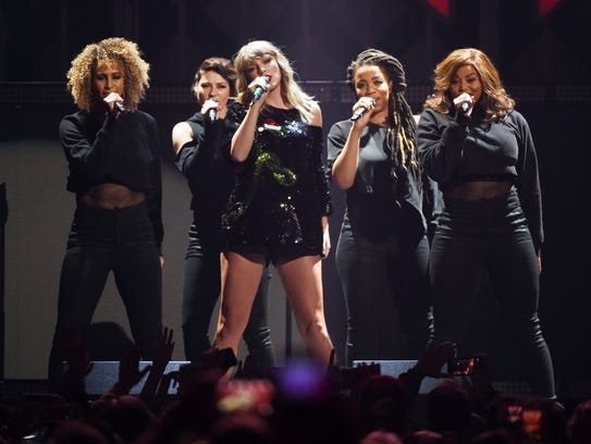 Taylor Swift, center, will perform Sept. 15, 2018,