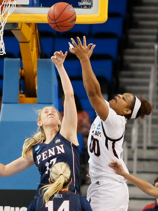 Penn center Sydney Stipanovich, left, and Texas A&M center Khaalia Hillsman, right, reach for a rebound during the first half of a first-round game in the NCAA women's college basketball tournament, Saturday, March 18, 2017, in Los Angeles. (AP Photo/Danny Moloshok)