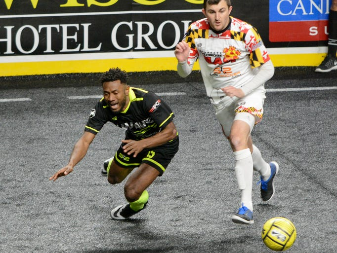 Milwaukee Wave defender Edder Nelson is tirpped by