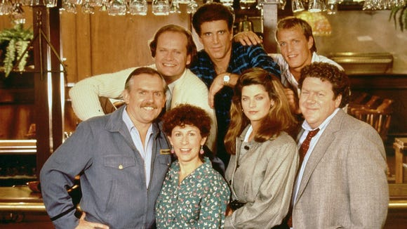 "The 1987 cast of ""Cheers"" featured (back row from left) Kelsey Grammer, ""Dr. Frasier Crane;"" Ted Danson, ""Sam Malone;"" and Woody Harrelson, ""Woody Boyd."" Front row from left: John Ratzenberger, ""Cliff Clavin;"" Rhea Perlman, ""Carla Tortelli;"" Kirstie Alley, ""Rebecca Howe"" and George Wendt, ""Norm Peterson."""