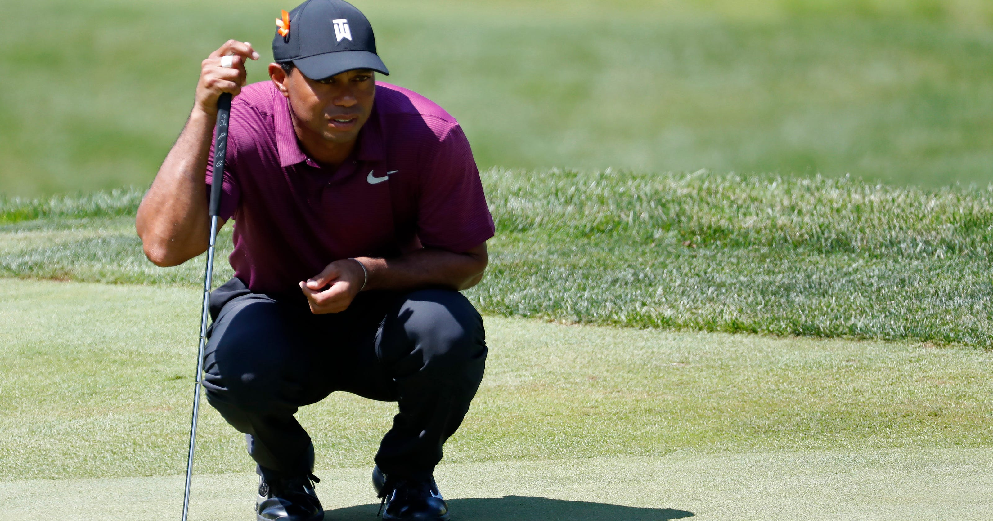 c50a9ff2435 Tiger Woods' new putter brings success, but change might be temporary