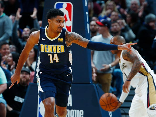 Denver Nuggets guard Gary Harris smiles as he gestures to the bench after hitting a basket against the New Orleans Pelicans in the first half of an NBA basketball game Friday, Nov. 17, 2017, in Denver. (AP Photo/David Zalubowski)