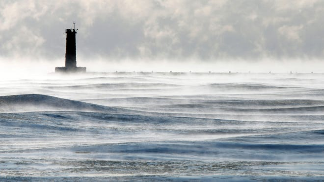 The lighthouse is mired in the depth of winter's chill along Lake Michigan Wednesday Jan. 7 in Sheboygan, Wisc.