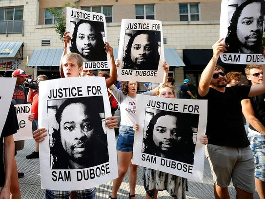 """Demonstrators chant """"No justice, no peace"""" during a"""