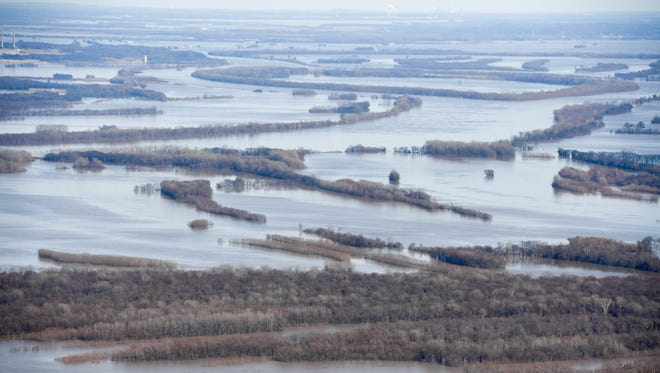 The confluence of the Ohio and the Wabash rivers looking west as the flooding Ohio River nears historic levels in the Tri-State Tuesday, February 27, 2018.
