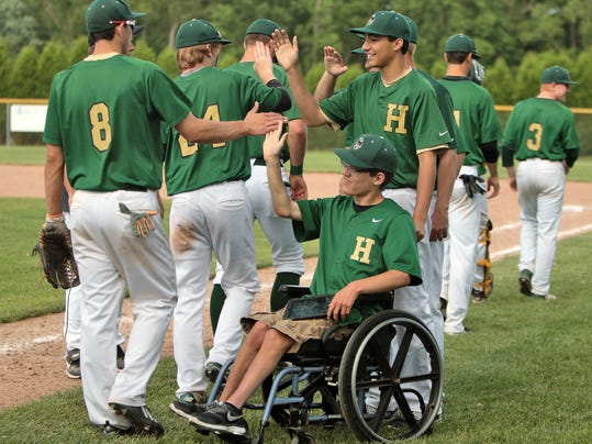 Howells baseball team givs high 5s after the game
