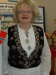 Carol Lee wears the traditional Norwegian bunad, a
