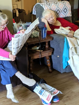 Mildred Johnson, 90, of Fort Smith, a subscriber for 70 years reads the paper to her sister Margaret Lee, 92, of Muldrow. This is a daily occurrence either over the phone or in person. They enjoy the Features, Sports and Living sections.
