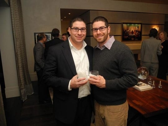 Twins Andy, left, and Chad Baker are real estate investors in the trendy East Nashville neighborhood of Tennessee's capital city.