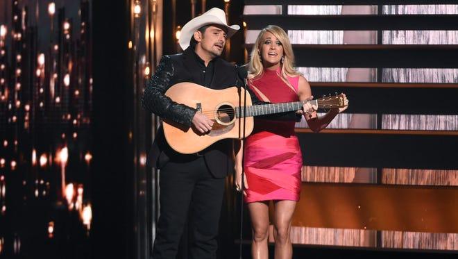 Hosts Brad Paisley, left, and Carrie Underwood speak at the annual CMA Awards at the Bridgestone Arena on Wednesday, Nov. 4, 2015, in Nashville, Tenn.