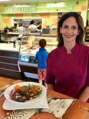 Chef Amy Visco Schmicker of Sanibel Fresh poses with her steak burrito bowl made from local, grass-fed beef.