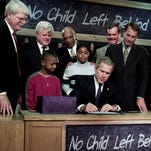 President George W. Bush  signs No Child Left Behind into law in 2002.