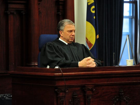 Judge Dirk Sandefur listens to statements from the