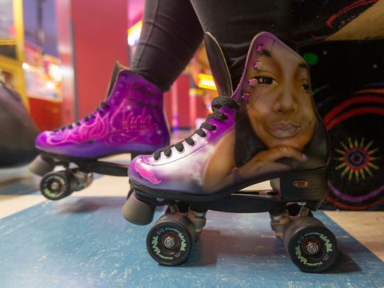 "Skates decorated with Jada Rankin's face and ""Selfies in Heaven,"" are worn by a friend of Jada Rankin, on Friday, April 28, 2017 in Detroit, at the 16th birthday party Jada will never have."
