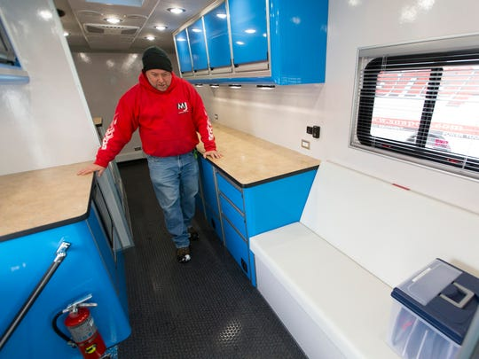 Delivery driver and trainer Jeff Clark walks through a completed mobile bone density clinic at LDV Inc. in Burlington. The vehicle was built for Gundersen Health System in La Crosse.