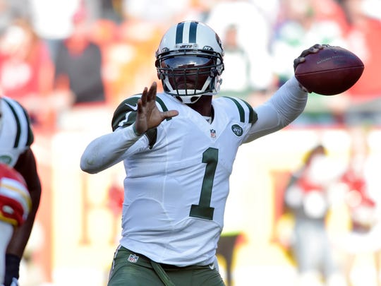 New York Jets quarterback Michael Vick (1) throws a pass during the second half against the Kansas City Chiefs at Arrowhead Stadium.