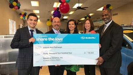 From left: Sam Spagnuolo, director, Subaru of America; Brandon Baker, president, Baker Auto Group; Mimi Baker; Michele Chevalier, motor vehicle clerk and sales consultant; and David Walker, Visions and Pathways executive director and CEO.