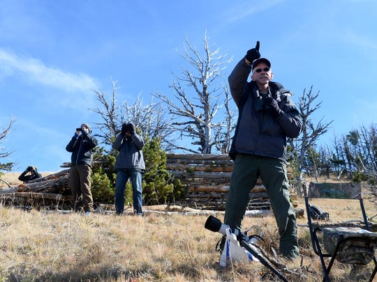 Dan Ellison points out a migrating raptor in the Big Belt Mountains.