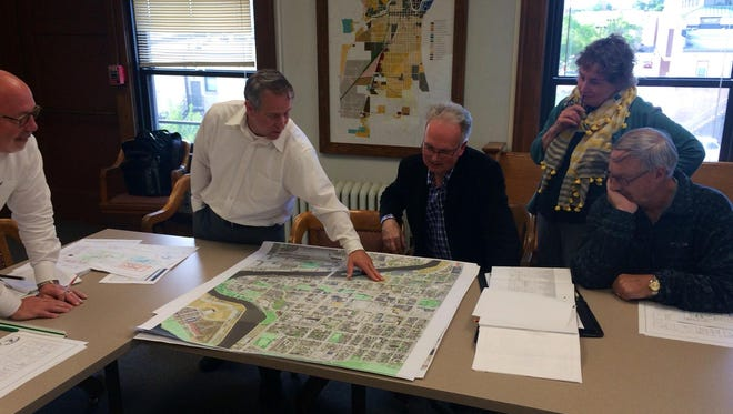 Director of Public Works Dave Biebel shows members of the Building Use Committee what city-owned land is available for future use. The committee is now considering alternative sites for City Hall.