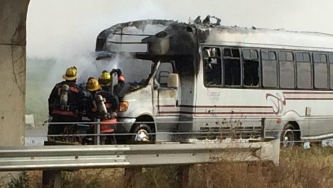 Grinnell fire fighters battle an engine fire on a Central College van underneath the Interstate 80 overpasson Highway 146 south of Grinnell on Thursday, Oct. 22.