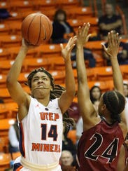 Najala Howell of UTEP takes a shot against NMSU's Brianna