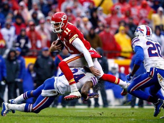 Quarterback Alex Smith of the Kansas City Chiefs carries