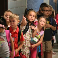 Kindergartners line up on the first day of school at Cobbles Elementary School in Penfield in this 2013 photo.