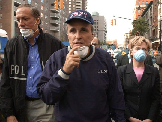 Sept. 12, 2001: Then-New York City Mayor Rudolph Giuliani leads then-New York Gov. George Pataki and then-Sen. Hillary Clinton on a tour of the site of the World Trade Center disaster.