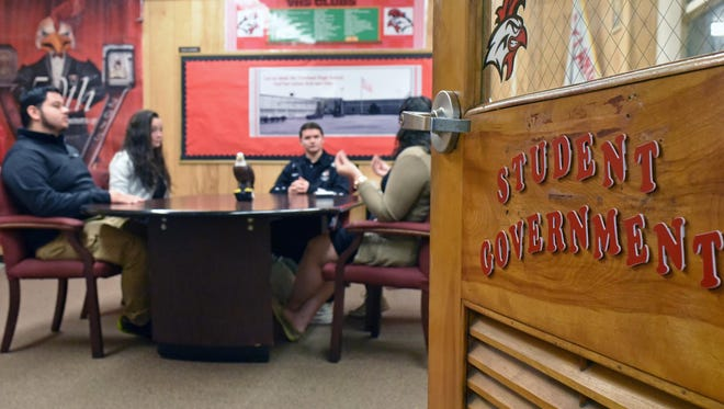 Student council members at Vineland High School gather inside a Student Activity Center.