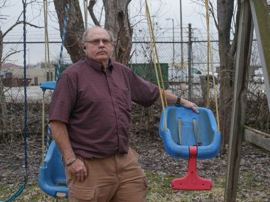 Charlie Demler worried that a proposed change to part of Carmel's land-use plan would allow a developer to build a three-story building right up to his backyard property line.