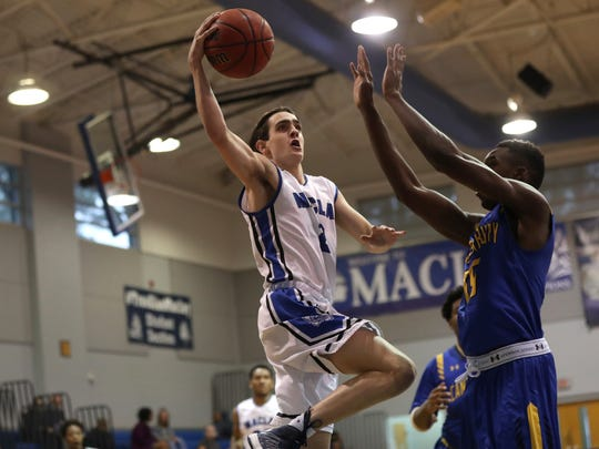 Maclay's Jack Murrah lays the ball up over Canterbury's
