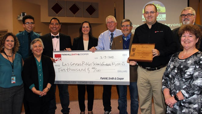 Erik Pfeifer, of Parkhill, Smith and Cooper, presents a check to the LCPS Foundation and the LCPS Board of Education Members and Superintendent Dr. Gregory Ewing on March 13, 2018.