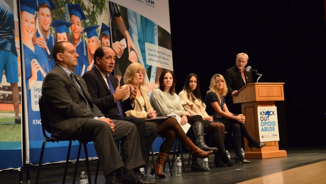 Middlesex County Prosecutor Andrew C. Carey; New Jersey State Senator Joseph Vitale (D -– Middlesex); Assemblywoman Nancy Pinkin (D – Middlesex); Vanessa Vitolo, outreach coordinator with Victory Bay Recovery Center; Bonnie Nolan, addiction services coordinator for Woodbridge Township; and moderator Bert Baron of 1450 WCTC participate in the Partnership for a Drug- Free New Jersey Knock Out Opioid Abuse Town Hall meeting in East Brunswick.