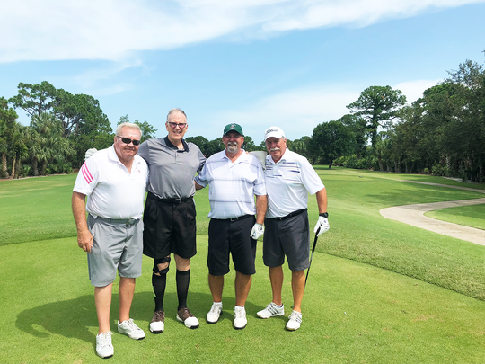 TCCH's Dr. Richard Carlin, left, and his teammates