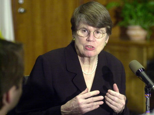 Then-attorney general Janet Reno addresses reporters