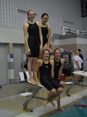 The D.C. Everest Middle School/Junior High 400-meter freestyle relay team members are, front from left, Maddie Van Erman and Bethany Rahn, and back from left, Sara Mayer and Cassie Neuendank.