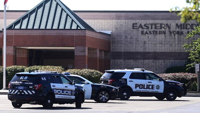 Lancaster and Lower Windsor Township officers respond to the second bomb threat this week at Eastern Middle School Thursday, Sept. 22, 2016. Amanda J. Cain photo