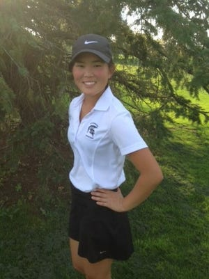 Livonia Stevenson girls golf captain Anna Vento is all smiles about how her senior year is going.