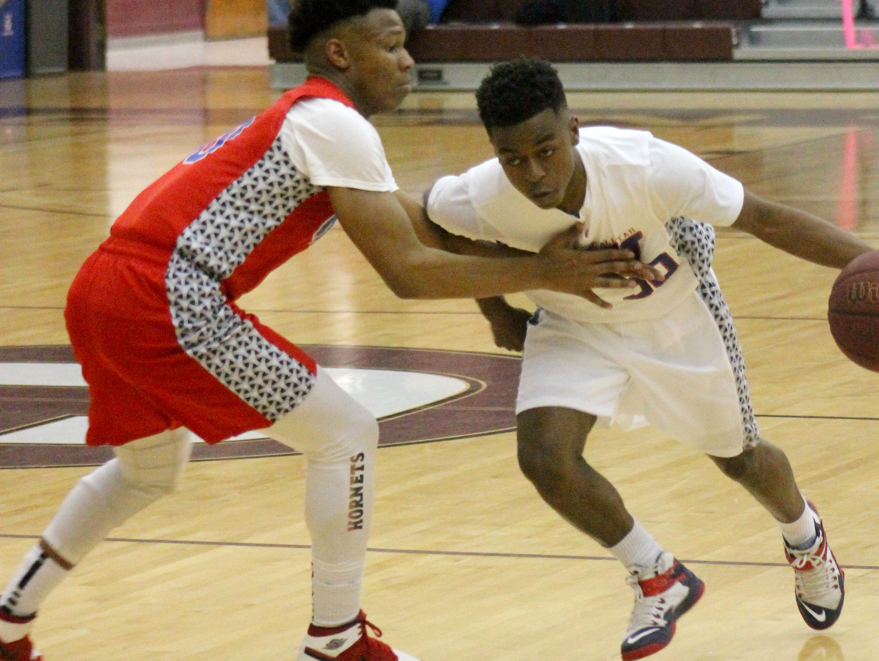 Evangel senior guard Bobby Armstrong drives against Arcadia's Danquarian Fields in the 8th annual I-20 Classic All-Star game.