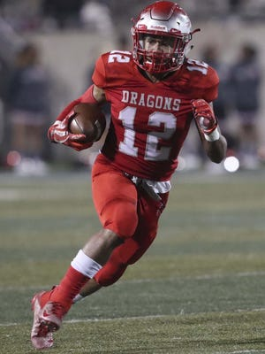 East's Richtell McCallister runs 26 yards for a touchdown against Buchtel last year at InfoCision Stadium in Akron.