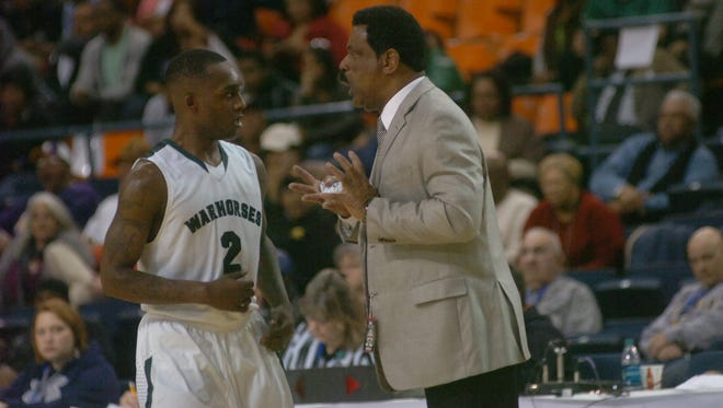 In 30 seasons as Peabody's coach, Charles Smith (right) has guided the Warhorses to 899 win, 25 district championships and six LHSAA titles.