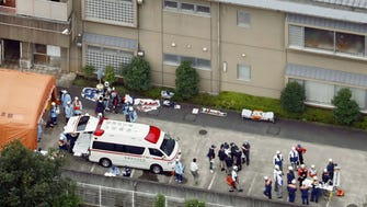 Ambulance crews and police are seen outside a facility for the disabled where a number of people were stabbed to death and injured July 26, 2016, in Sagamihara, outside Tokyo.