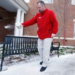 Harley Saxton spreads ice melting pellets on the sidewalk leading to The Inn at the University of Mississippi in Oxford Thursday. Sleet and snow continued Thursday morning across a wide belt of Mississippi, even as precipitation ended in the northwest part of the state.