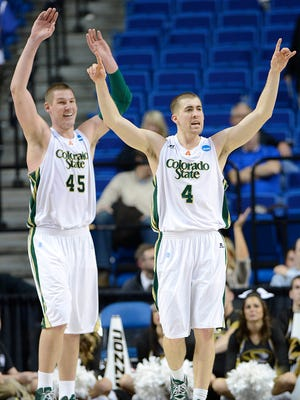CSU basketball players Colton Iverson, left, and Pierce Hornung celebrate following the Rams' 48-72 win over Missouri in an NCAA tournament game  March 22, 2013, in Lexington, Ky.