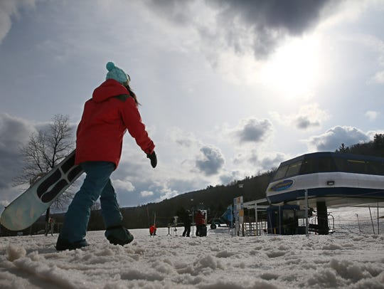 Christie Stanzione, Henrietta, heads to a lift as snow