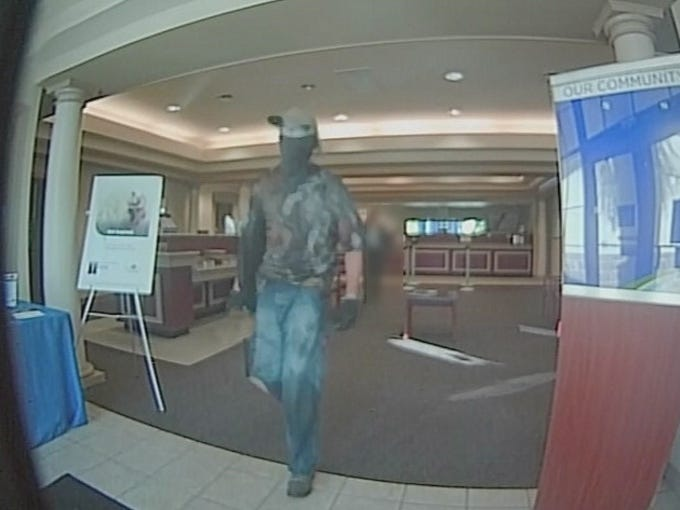 A <a href=https://www.news-press.com/story/news/crime/2015/05/27/robber-fires-gun-during-east-naples-fifth-third-bank-branch-heist/28008321/>masked